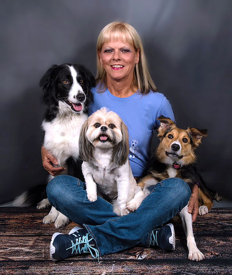 Mary Schelling and three dogs
